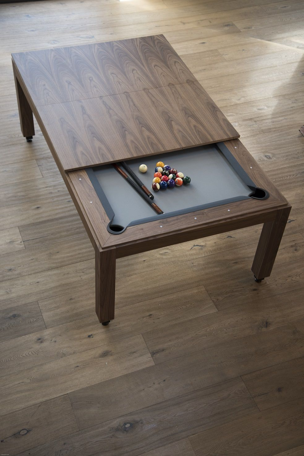 Pool table and then it can lower to a comfortable dining room table ...