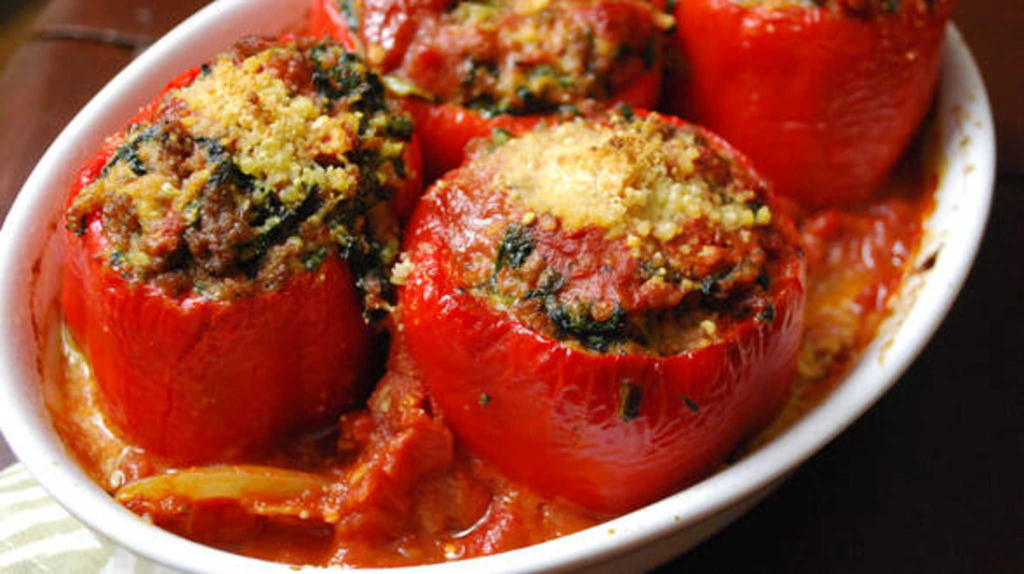 Meatball-Stuffed Peppers with Spinach and Garlic.