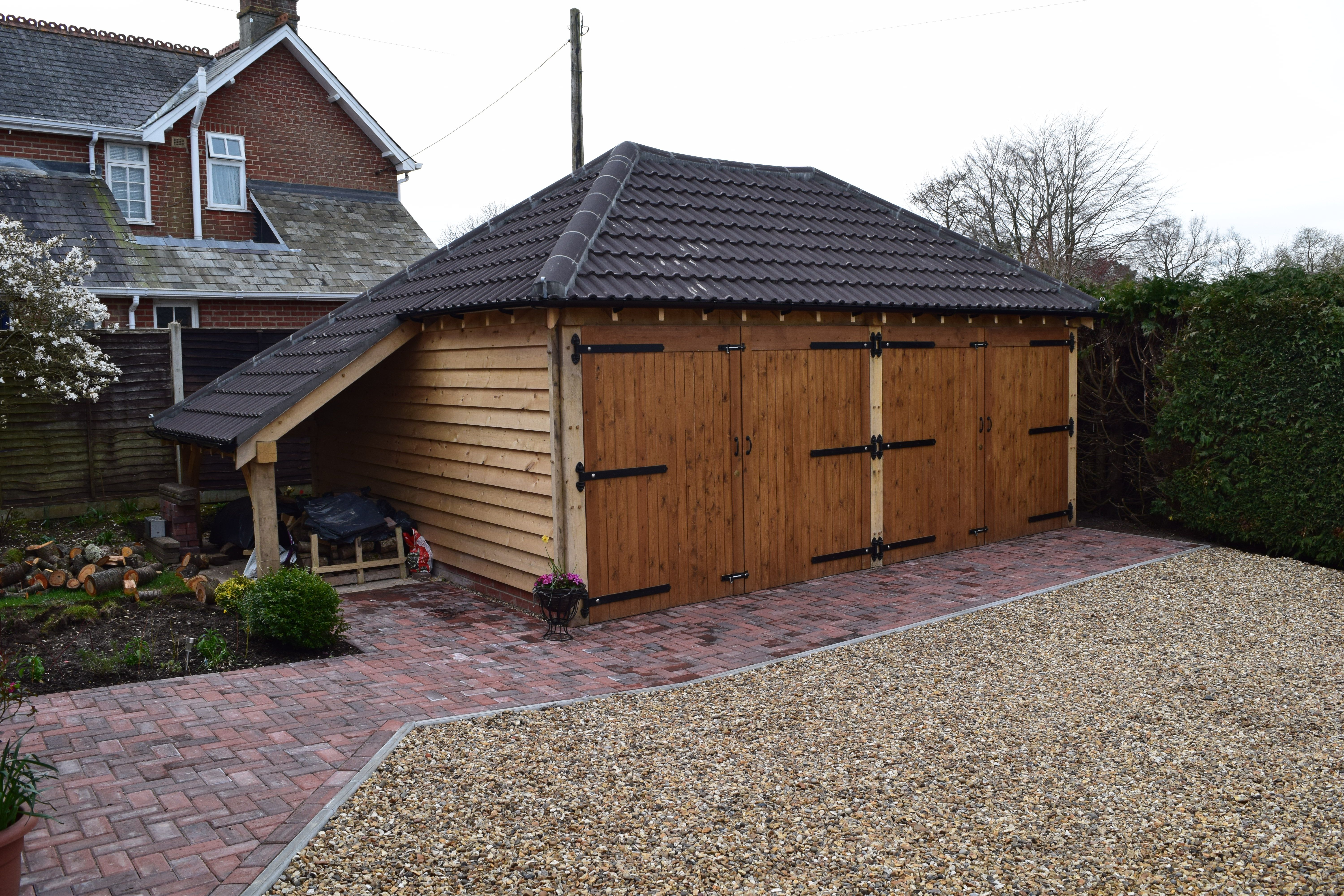 2 bay Oak Garage with a fully hipped roof  On the side is