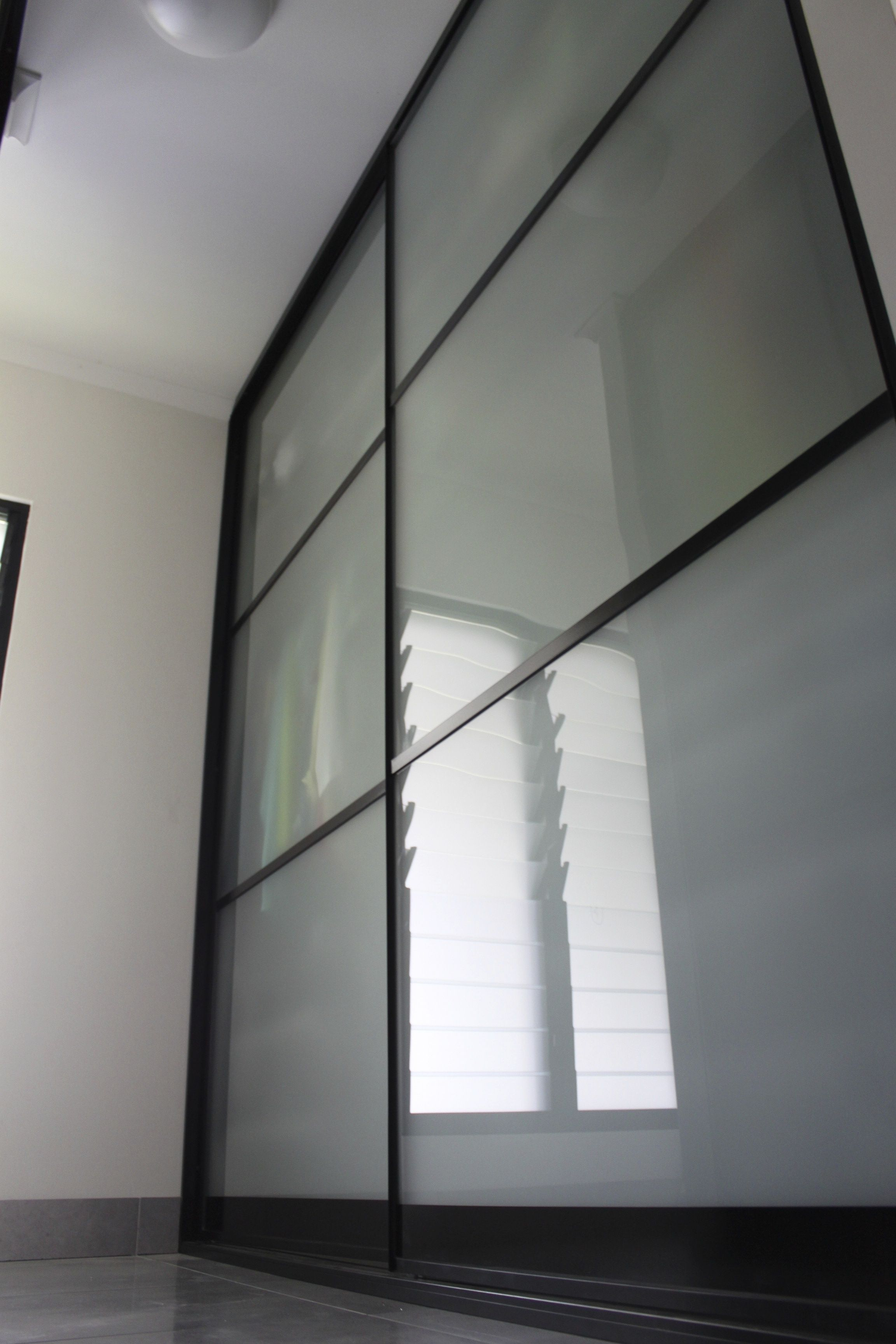 3 Panel Sliding Doors Using Frosted Glass With Black Frames Spinta