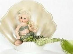 A Little Mermaid $75.96 What a great idea for a baby shower Center Piece....Under the sea this beautiful Little Mermaid waits for thee. She has pale blonde curly hair down to her waist, and sits on a pink cushion inside her mother of pearl finished sea shell wearing a pretty sea green bikini top over her lovely sea foam green tail. She is fully articulated. What fun she's having under the waves! Retired, limited supply. Visit duchessoutlet.com