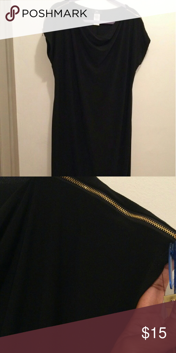 "Black zipper dress Black dress 41"" long 96%ploy and 4% spandex. Size 1x has great stretch. Dresses Midi"
