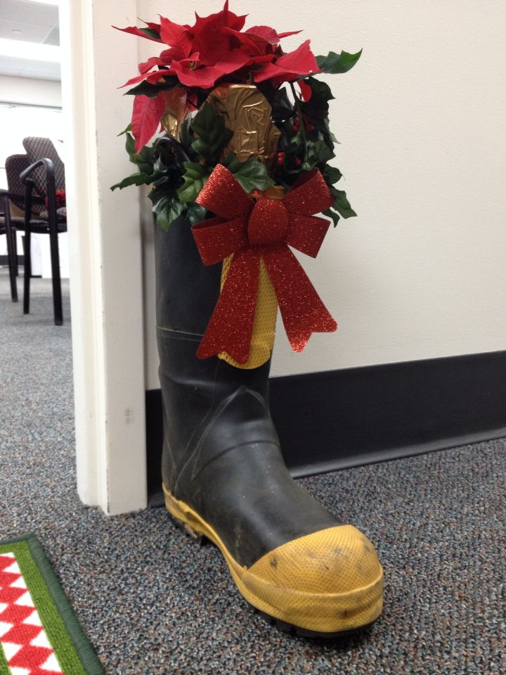 e3277bd505470 Fire Department Christmas Decorating  Fireman boots with poinsettias ...