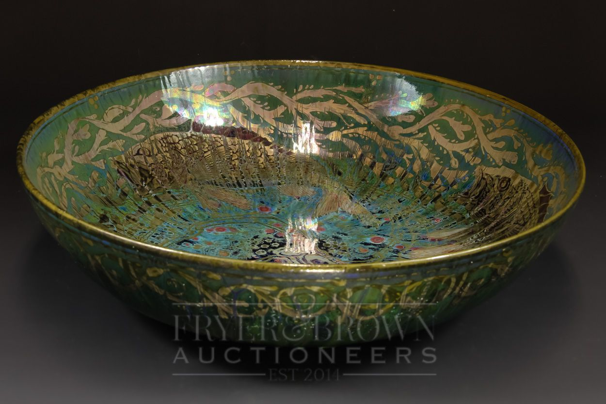 A large Pilkingtons Royal Lancastrian lustre bowl, decorated by Richard Joyce with fish in seawe...