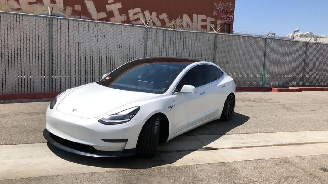 First Look At The Up Durable Urethane Front Lip Spoiler Installed Unpainted On This Slammed Dual Motor Performance Model 3 First Fro Tesla Model Model Tesla