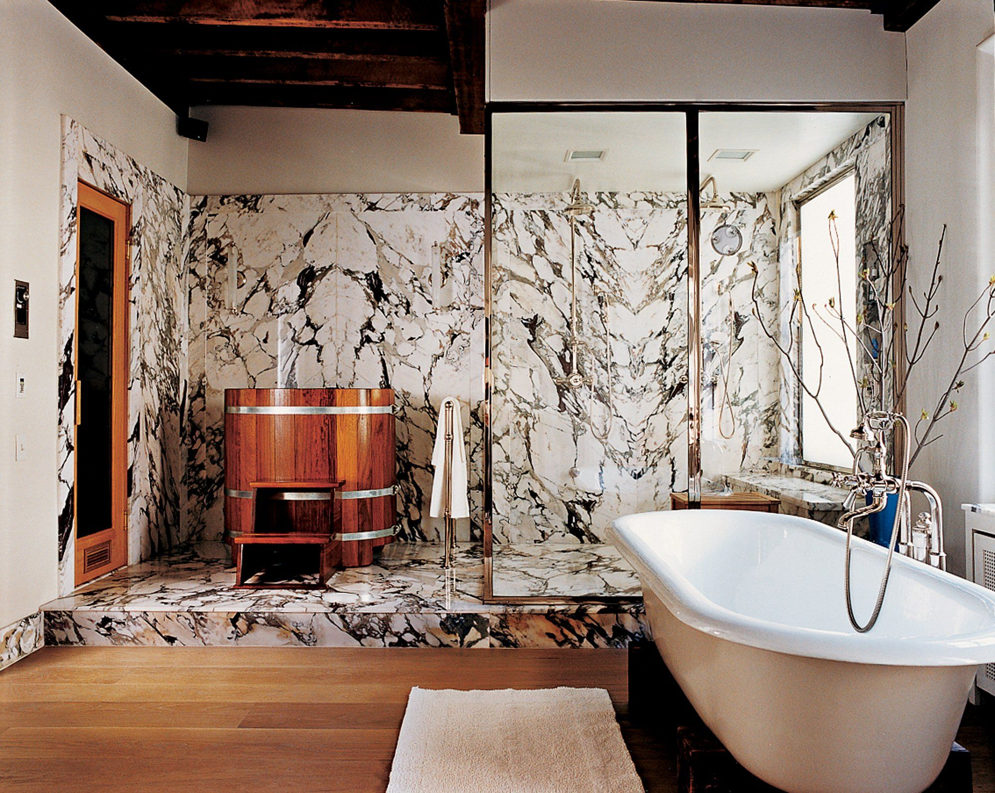 A Wooden Cold Tub And Marble Walls Fill The East