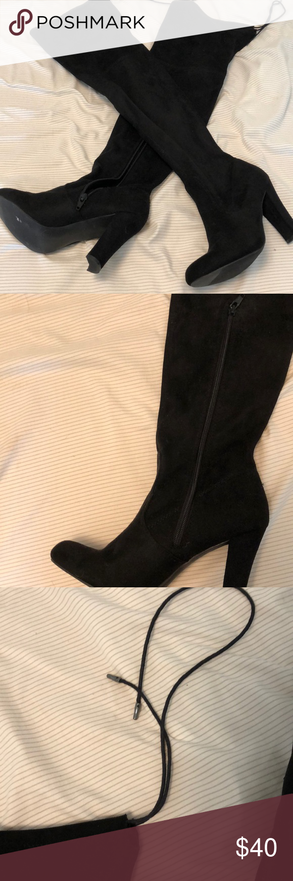 Knee high black suede heeled boots from