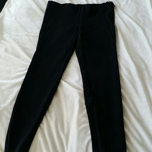 Black dress pants These are fitted, with stretch to them. Zippered side, low cut waist. Legs are zippered to narrow bottom. really good shape! Blend of rayon, nylon and 5% spandex. Kenar Pants