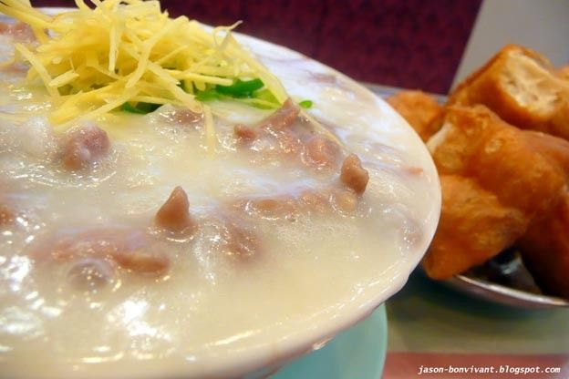 hong kong breakfast sliced beef congee with raw eggs with