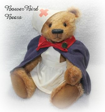Flo 18 inch high mohair bear dressed in vintage nurse's cap and cape