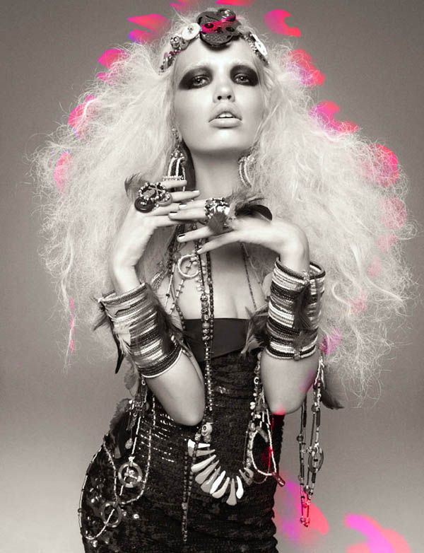 Daphne Groeneveld by Greg Kadel for a tribal-meets-electric candy spread for Numéro #124