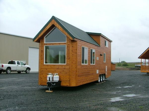 Little House On Wheels large window on end of 8 foot wide tiny houserich the cabin