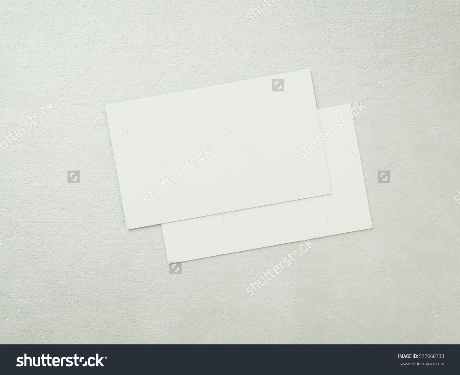 Two blank business cards with white paper texture corporate two blank business cards with white paper texture corporate identity mock up on concrete surface 3d rendering reheart Gallery