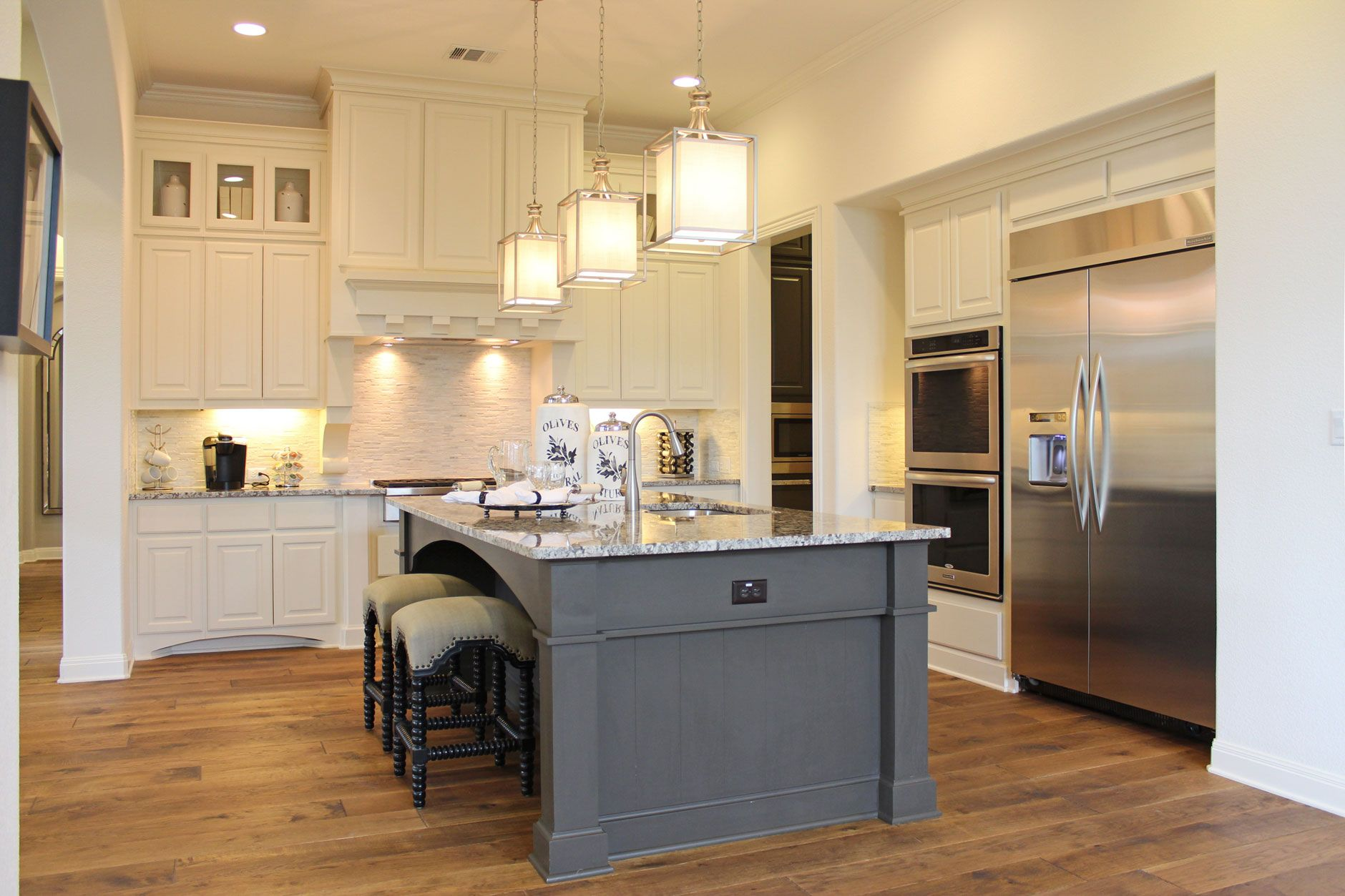 burrows cabinets kitchen cabinets in bone white and gray island with glass door panels in on kitchen cabinets with glass doors on top id=99382
