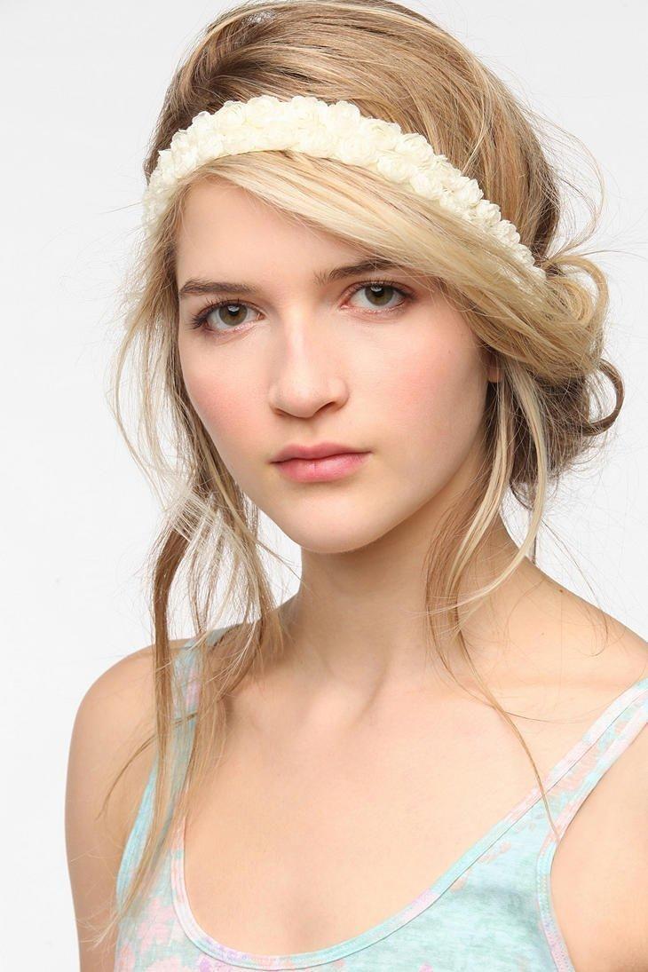 Well executed touseled hair w head band look hair nails skin