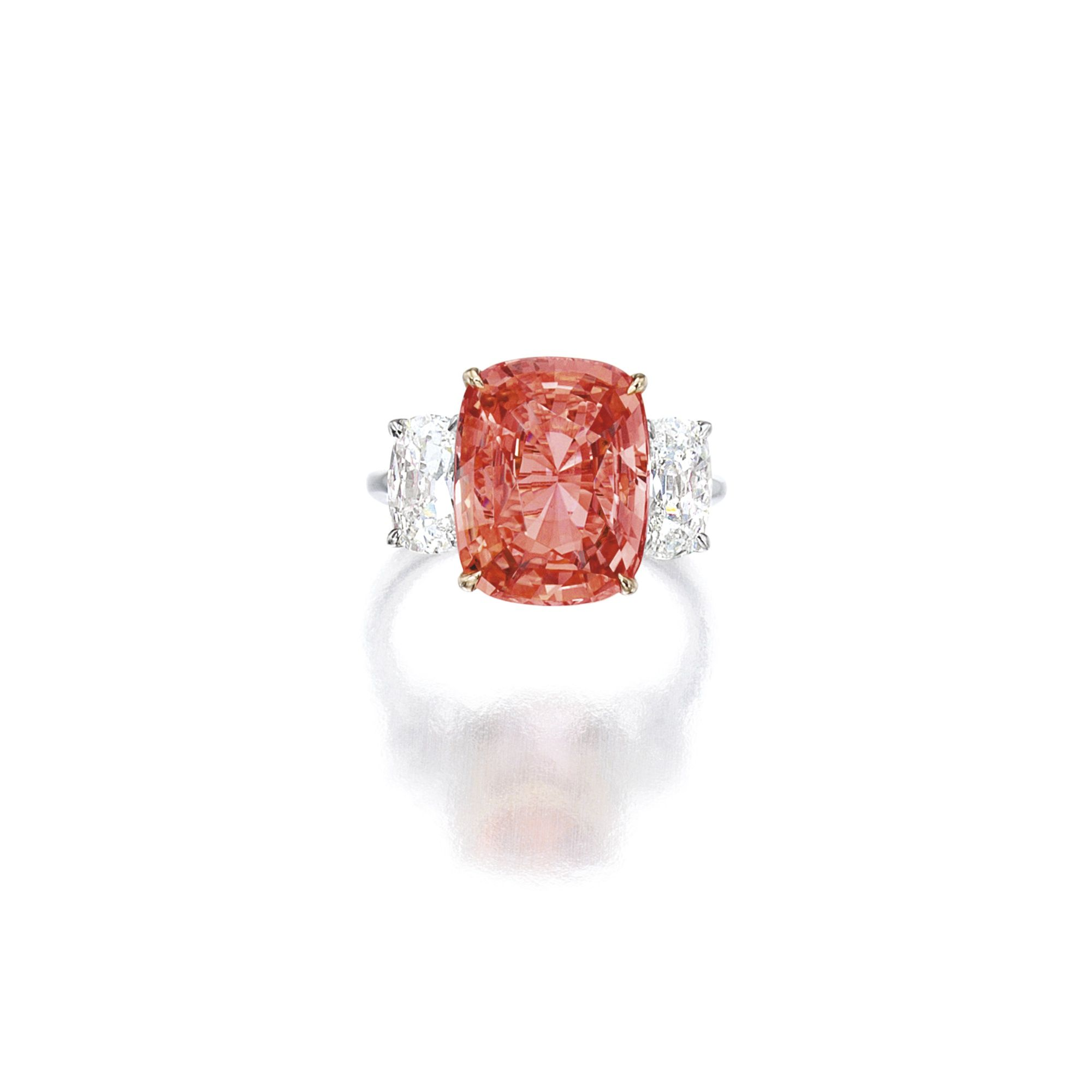 Padparadscha sapphire and diamond ring set with a cushionshaped