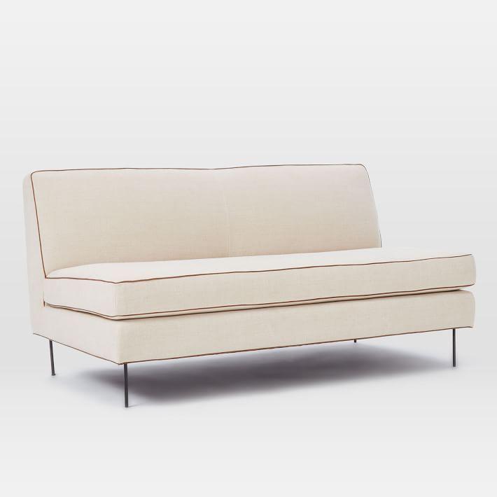 Charming Modern Armless Sofa With Piped Edge Cushions