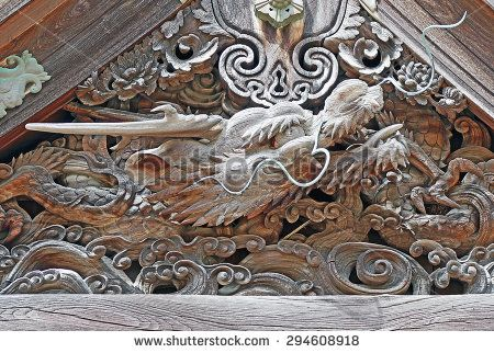 Color Painting Ancient Japanese Wood Carving of Sacred Dragon Head inside Old Temple at Mount Koya on Sandstone Texture