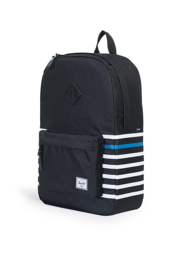 9f0569bb5b0 The classic Offset Herschel Heritage backpack features a functional design  with screen printed naval stripes and a vegetable tanned leather diamond.