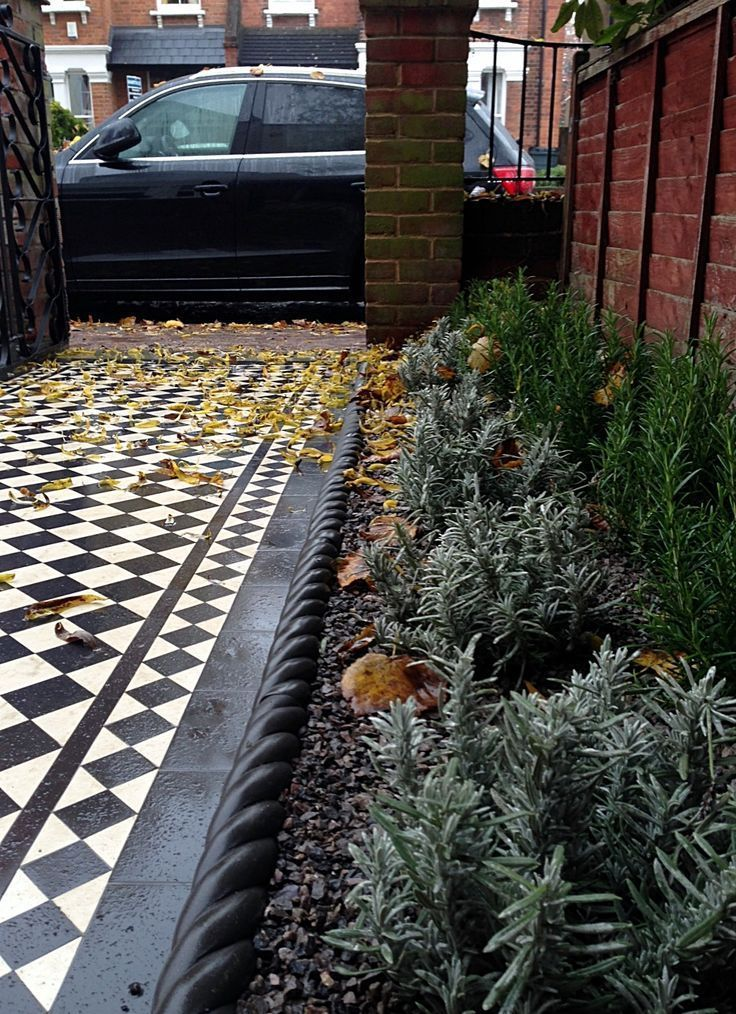 Photo of Victroian black and white mosaic tile garden path pavement formal planting Buxus…