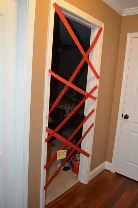 Elf on the shelf ideas elf wraps childs bedroom door with streamer - goodbye note