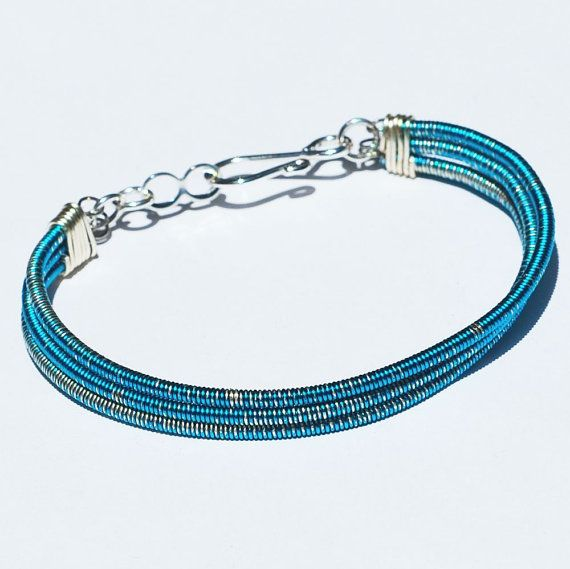 bass guitar string bracelet 3 strand electric blue products guitar string bracelet guitar. Black Bedroom Furniture Sets. Home Design Ideas