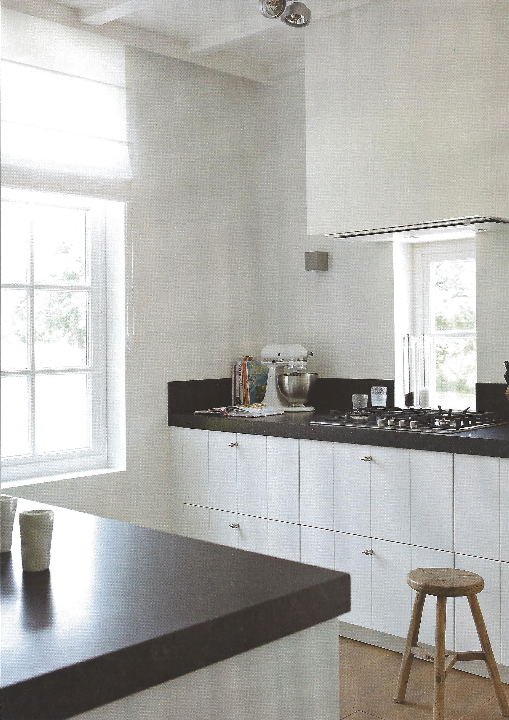 Uncluttered White Cabinets Black Soapstone Countertops Stainless Liances And Ings
