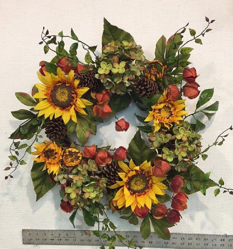 Photo of Autumn elegance sunflower wreath