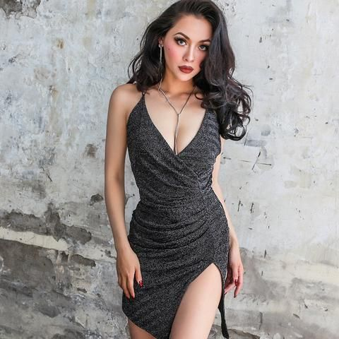 5789e4ddc43 A deep v neck sleeveless dress with flattering pattern with a slit on thigh  gives you
