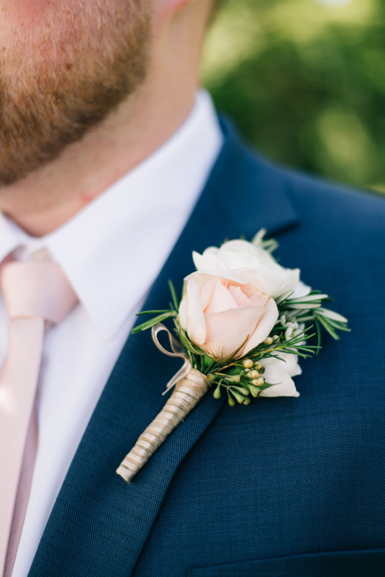 Navy and white groomgroomsmen boutonniere