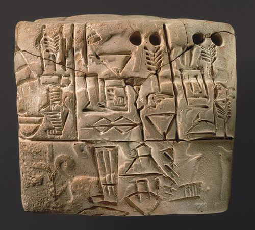 Administrative tablet with cylinder seal impression of a male figure, hunting dogs, and boars, 3100–2900 b.c.; Jemdet Nasr period (Uruk III script)  Mesopotamia  Clay
