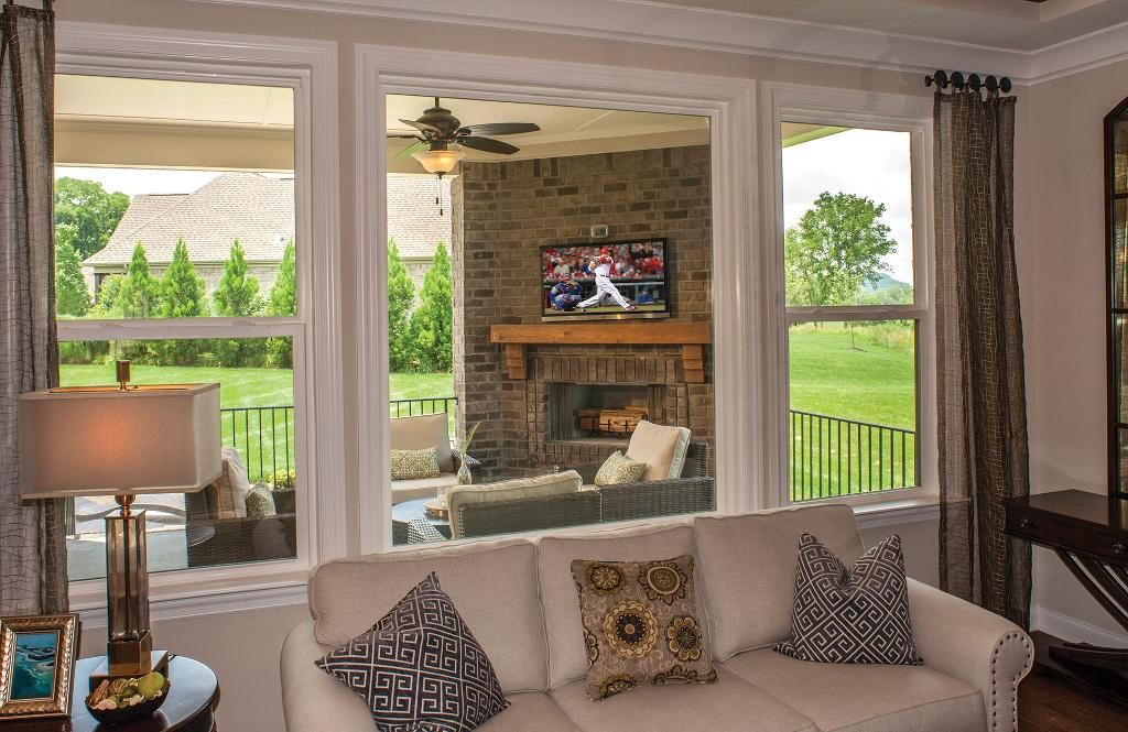 Outdoor living are with brick fireplcase; The Colton floor plan ...