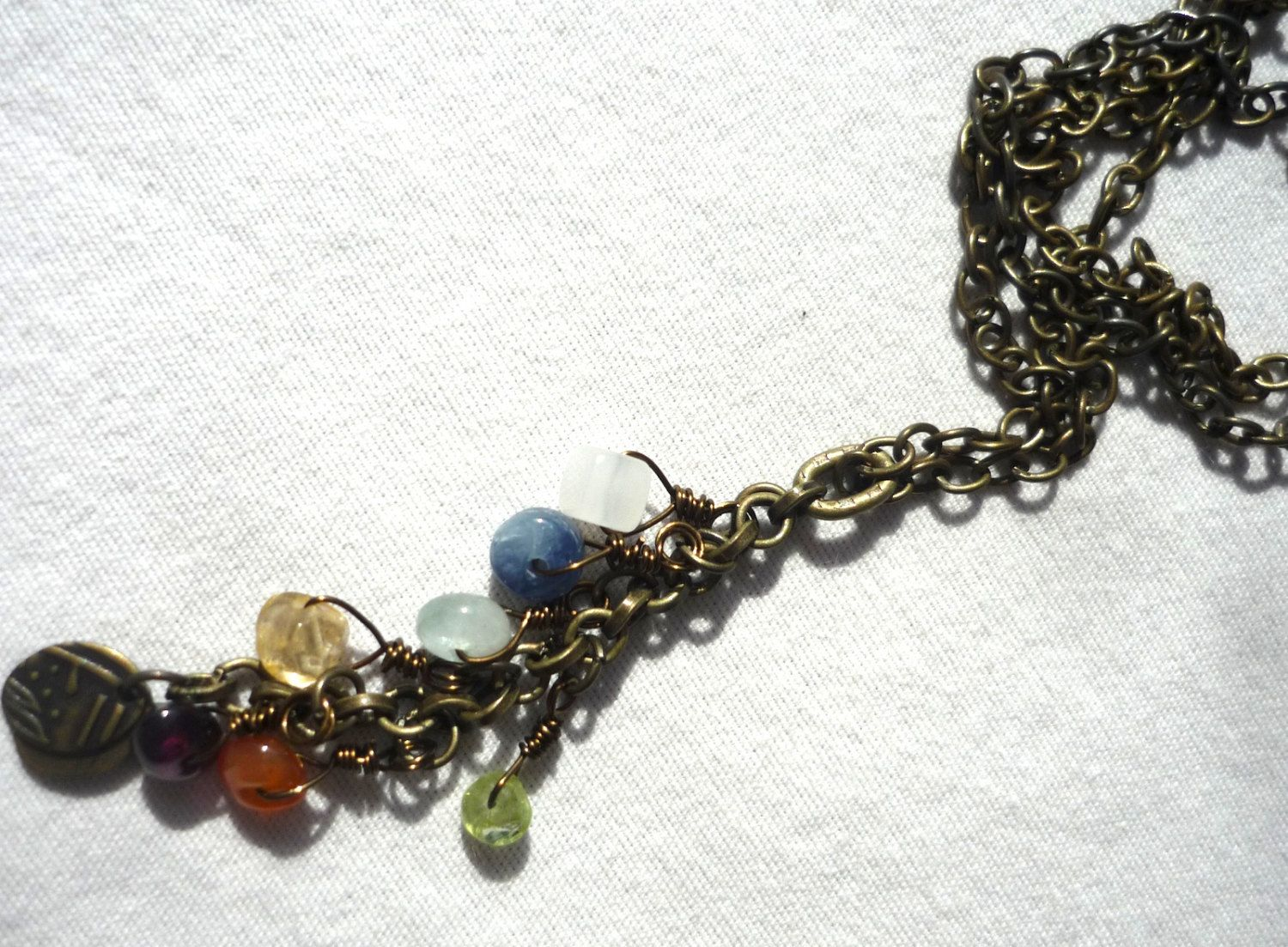 New chakra jewelry is available now! Chakra stone and brass chain necklace. $24.00, via Etsy.