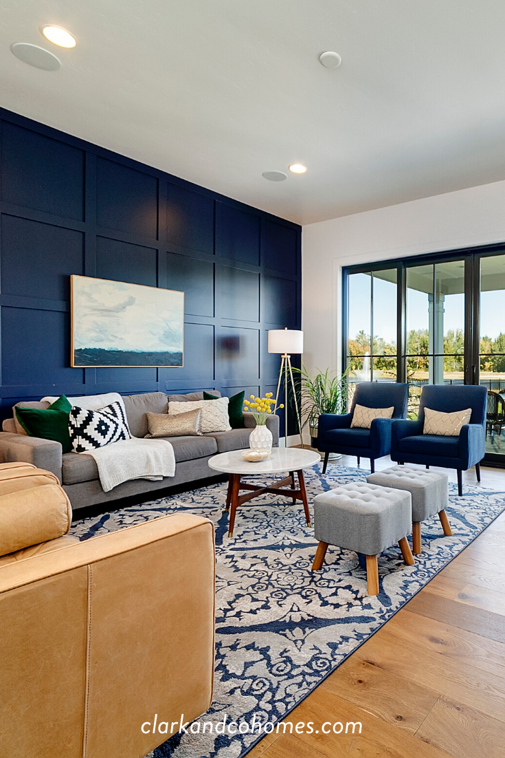 A Navy Blue Accent Wall With A Custom Grid Millwork Detail Brings