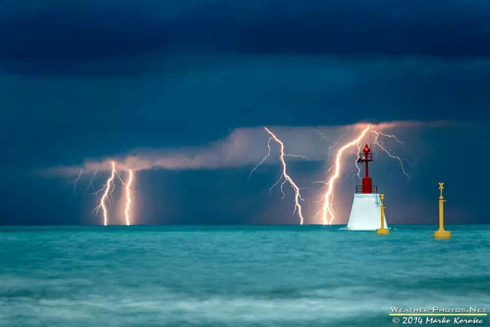 An approaching storm with intense cloud-to-ground lightning strikes over the Adriatic Sea on July 12 2014