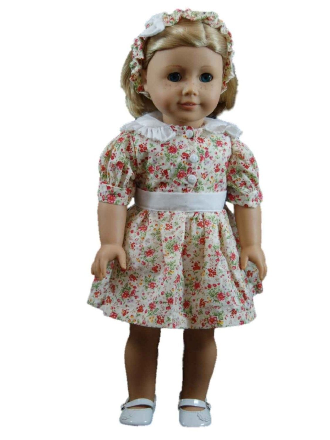 Doll Clothing! Sized perfectly for 18 inch dolls, such as, American Girl Dolls. Nostalgic vintage floral cotton print creates the most adorable 1930's inspired dress. Matching headband included. (Shoes sold separately). Designed and Manufactured by us, The Queen's Treasures.