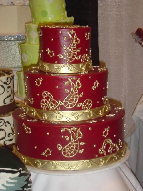 3f03d6715290 3 tier round cake iced in red with a gold design. Celebration cakes by  Cake-a-Fare www.cakeafare.com