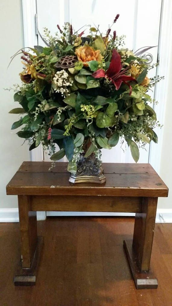 low floral arrangement dining room table entry table