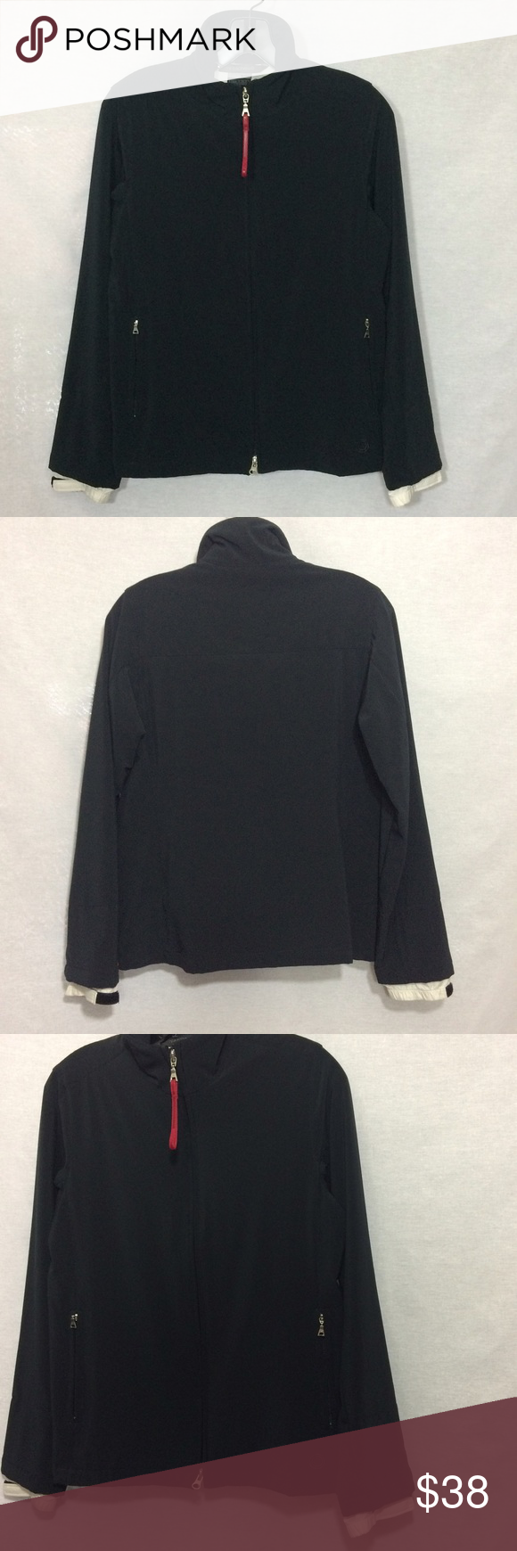 """Nike Sphere Running Jacket Perfect for those crisp early morning runs. Jacket features two outside zipper pockets, 2 interior pockets (pic 4) and contrasting, adjustable sleeve cuffs (pic 2). 23.5"""" length. Good, used condition - no rips, holes or stains. Nike Jackets & Coats"""