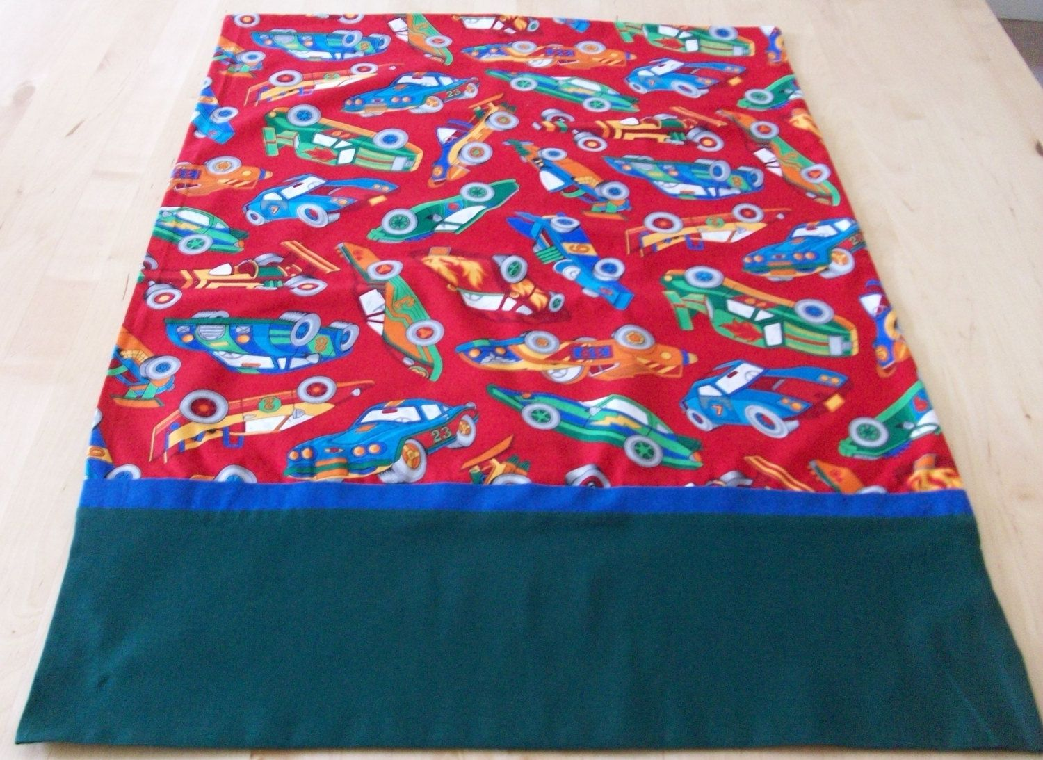 Brightly colored race cars pillowcase with French seams by JamesRiverCrafts on Etsy
