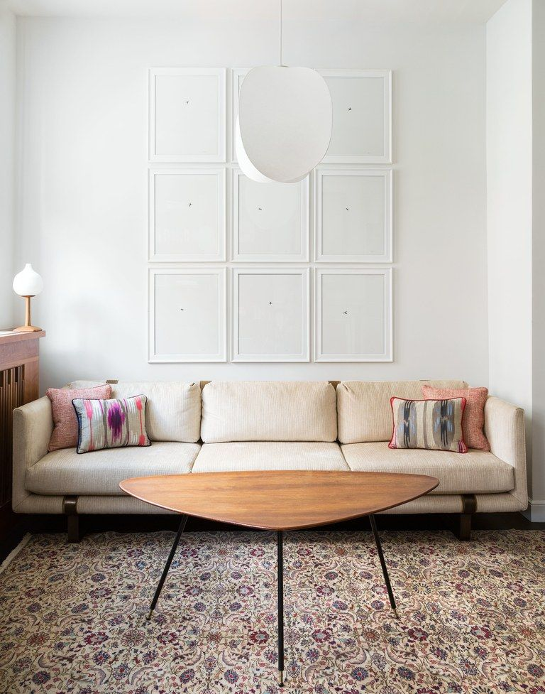 This MidcenturyModern NYC Apartment Was Inspired by Japanese Design is part of Big Living Room Art - Funky lights, custom radiator covers, and builtins beyond belief