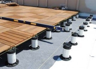 Tile Tech Pedestal System Is Designed For Concrete Pavers To Lay Level Over A Built Up Roof Wood Deck Tiles Deck Tile Wood Deck