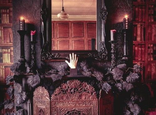 Beautiful black mantel with leaves and candle sticks Gothic living - funny halloween decorating ideas
