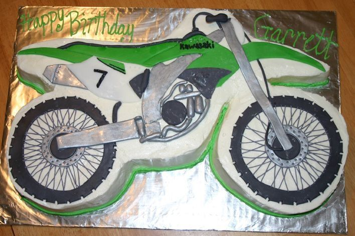 Dirt bike cake covered in buttercream and made out of for What is dirt made out of