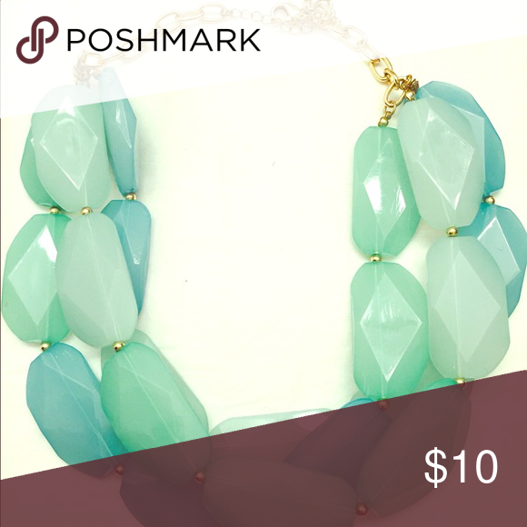 Statement Necklace This statement necklace is a mix of mint and aqua pieces that look great with a simple white tee or over a dress-lots of options to play with! Jewelry Necklaces