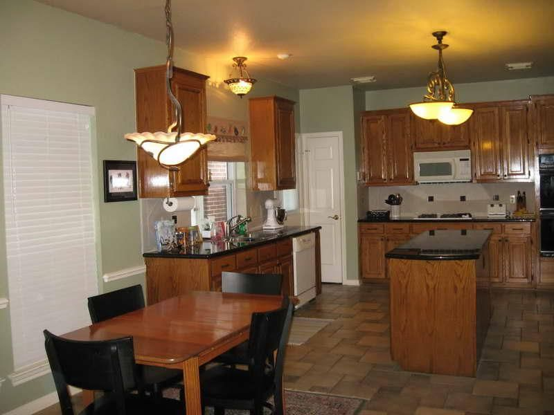 honey oak cabinets with dark wood floors Google Search