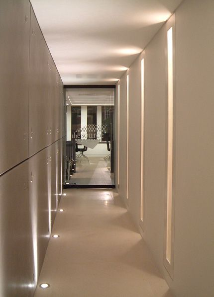 Uplighting in long hallways commercial hospitality for Office hallway design