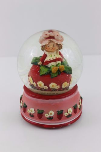A strawberry shortcake snow globe from the 1980s