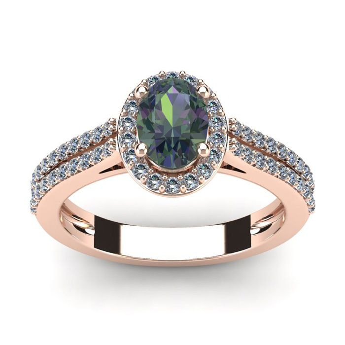 1 1/2 Carat Oval Shape Mystic Topaz and Halo Diamond Ring In 14 Karat Rose Gold: This stunning gemstone and diamond ring features… #Jewelry