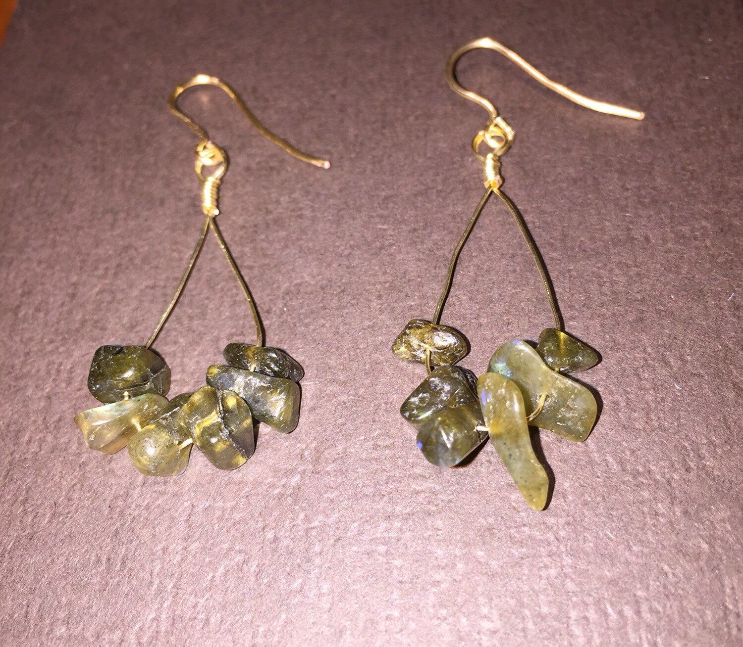 A personal favorite from my Etsy shop https://www.etsy.com/listing/248790081/labradorite-and-gold-earrings
